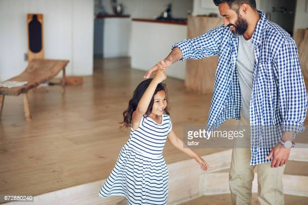 another twirl, dad! - father daughter stock pictures, royalty-free photos & images