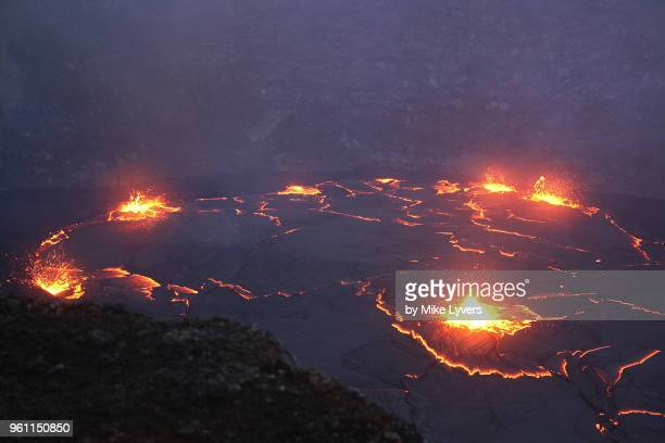 another view down to the spattering lava lake far below in the crater of pu'u o'o. - pu'u o'o vent stock pictures, royalty-free photos & images