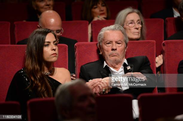 Anouchka Delon and Alain Delon attend the screening of A Hidden Life during the 72nd annual Cannes Film Festival on May 19 2019 in Cannes France