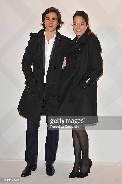Anouchka Delon and boyfriend Julien attend the Burberry Paris Boutique Opening At British Embassy on December 1 2011 in Paris France