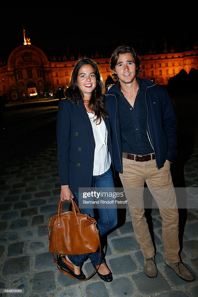 Anouchka Delon (L) and her companion Julien Dereins attend the 'Claude Lelouch en Musique ! Held at the Invalides in Paris on September 6, 2014 in Paris, France.