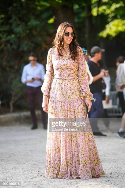 Anouchka Delon wears a pink flower print pleated dress outside Giambattista Valli during Paris Fashion Week Haute Couture Fall Winter 2018/2019 on...