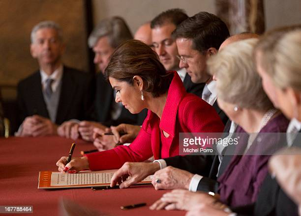 Anouchka van Miltenburg signs the Act of Abdication by Queen Beatrix of the Netherlands in the Moseszaal at the Royal Palace on April 30 2013 in...