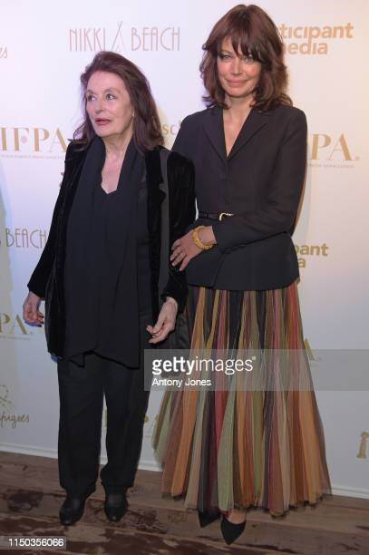 Anouck Aimee and Marianne Denicourt attend the HFPA Participant Media Honour Help Refugees' during the 72nd annual Cannes Film Festival on May 19...