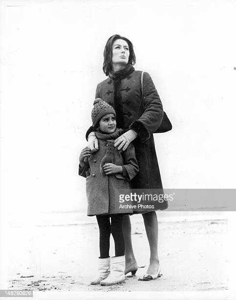 Anouk Aimée with child in a scene from the film 'A Man And A Woman' 1966