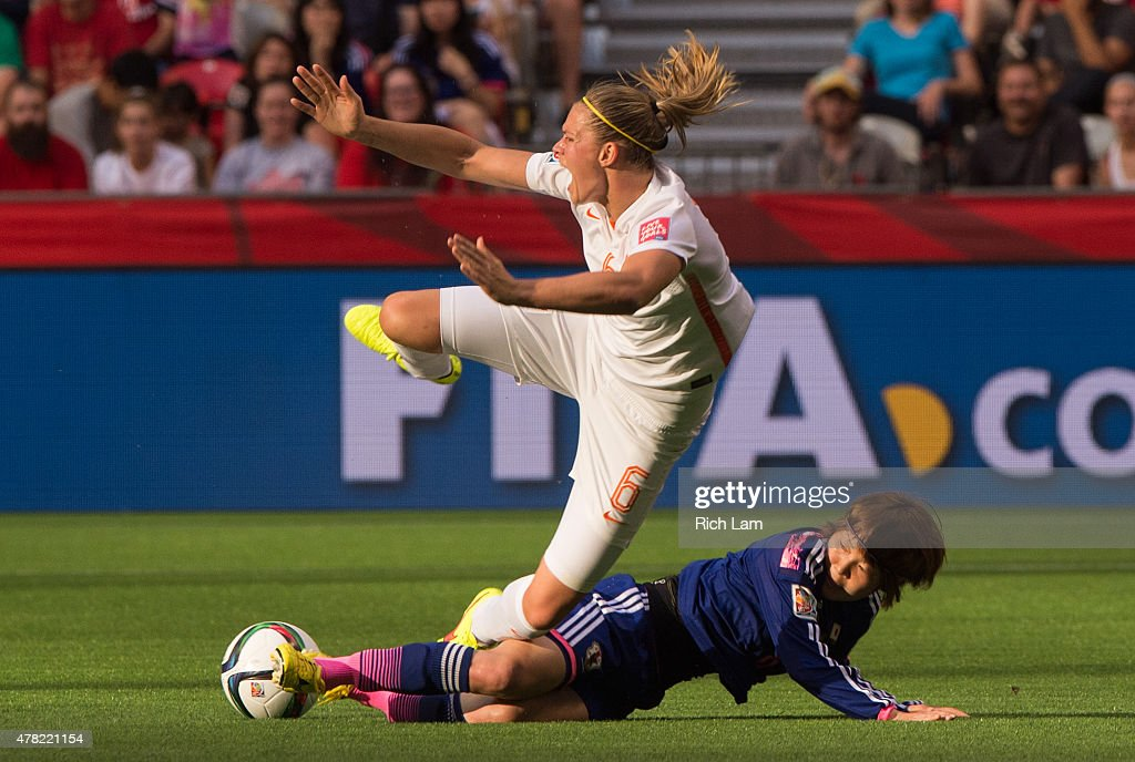 Anouk Dekker #6 of the Netherlands reacts while falling after getting tackled by Mizuho Sakaguchi #6 of Japan during the FIFA Women's World Cup Canada 2015 Round of 16 match between the Netherlands and Japan June, 23, 2015 at BC Place Stadium in Vancouver, British Columbia, Canada.