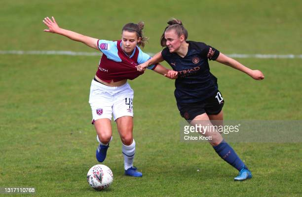 Anouk Denton of West Ham United and Georgia Stanway of Manchester City battle for the ball during the Barclays FA Women's Super League match between...