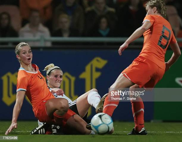 Anouk Hoogendijk and Karin Legemate of Netherlands tackle Anja Mittag of Germany during the Womens European Championships qualification match between...
