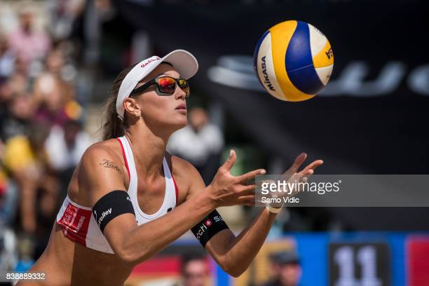 Anouk VergeDepre of Switzerland serves the ball during the match against Laura Ludwig and Kira Walkenhorst of Germany during Day 3 of the Swatch...