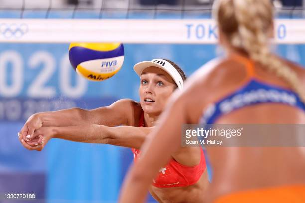 Anouk Verge-Depre of Team Switzerland competes against Team Netherlands during the Women's Preliminary - Pool A beach volleyball on day three of the...
