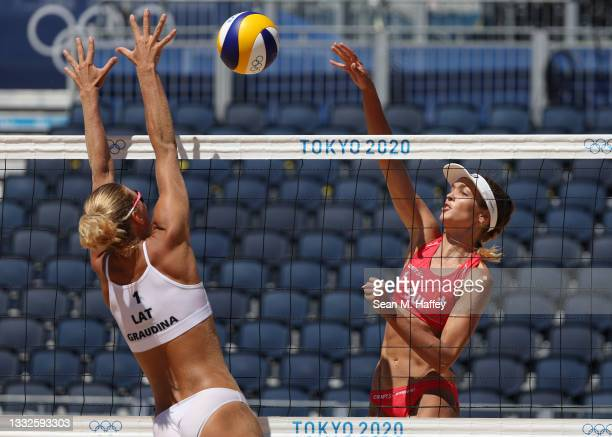 Anouk Verge-Depre of Team Switzerland hits the ball against Tina Graudina of Team Latvia during the Women's Bronze Medal Match on day fourteen of the...