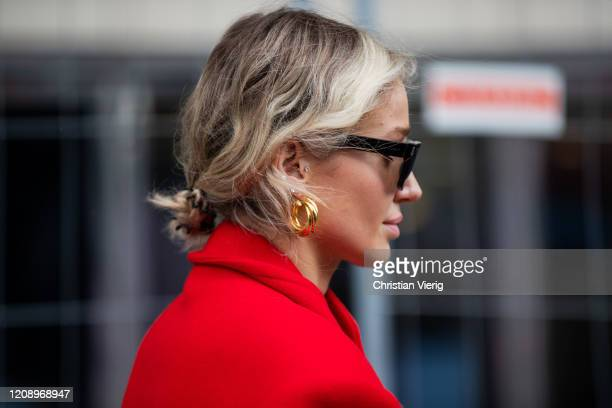 Anouki Areshidze is seen wearing red wool coat, sunglasses outside Dries van Noten during Paris Fashion Week - Womenswear Fall/Winter 2020/2021 : Day...