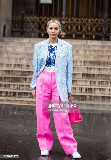 Anouki Areshizde is seen wearing pink wide leg pants Hermes bag blazer with print in blue outside Stella McCartney during Paris Fashion Week...