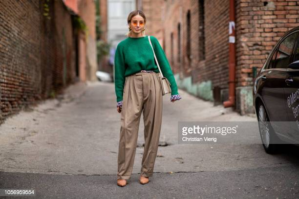 Anouki Kaladze wearing green knit brown high waist pants is seen during MercedesBenz Tbilisi Fashion Week on November 3 2018 in Tbilisi Georgia