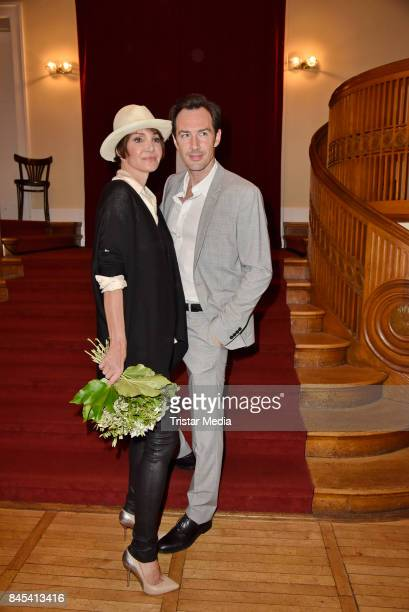 Anouschka Renzi and Arne Stephan attend the premiere of 'Die Kameliendame' at Schlosspark Thetaer on September 10, 2017 in Berlin, Germany.