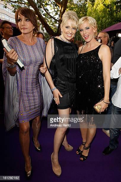 Anouschka Renzi Designer Olga Roh and Eva Habermann attend the Rohmir Store first birthday party on September 5 2012 in Berlin Germany