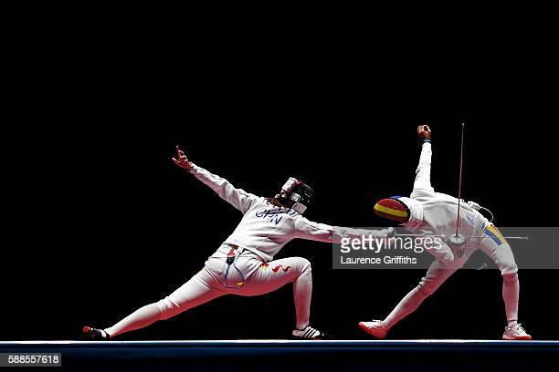 Anqi Xu of China competes against Simona Gherman of Romania during the Women's Epee Team Gold Medal Match bout on Day 6 of the 2016 Rio Olympics at...