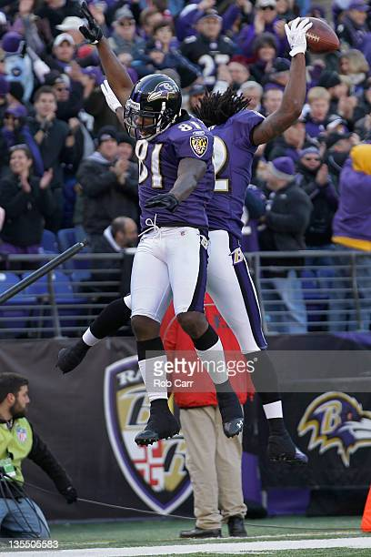 Anquan Boldin and Torrey Smith of the Baltimore Ravens celebrate Smith's touchdown catch against the Indianapolis Colts during the first half at M&T...