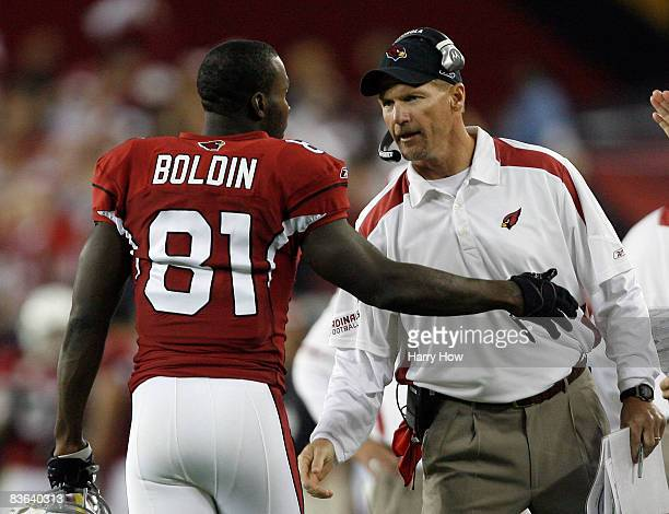 Anquan Boldin of the Arizona Cardinals celebrates his touchdown with coach Ken Whisenhunt against the San Francisco 49ers during the second quarter...