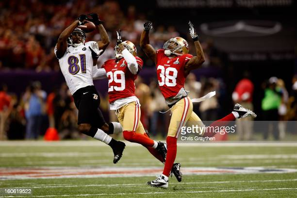 Anquan Boldin of the Baltimore Ravens attempts to catch a pass in front of Chris Culliver and Dashon Goldson of the San Francisco 49ers in the second...