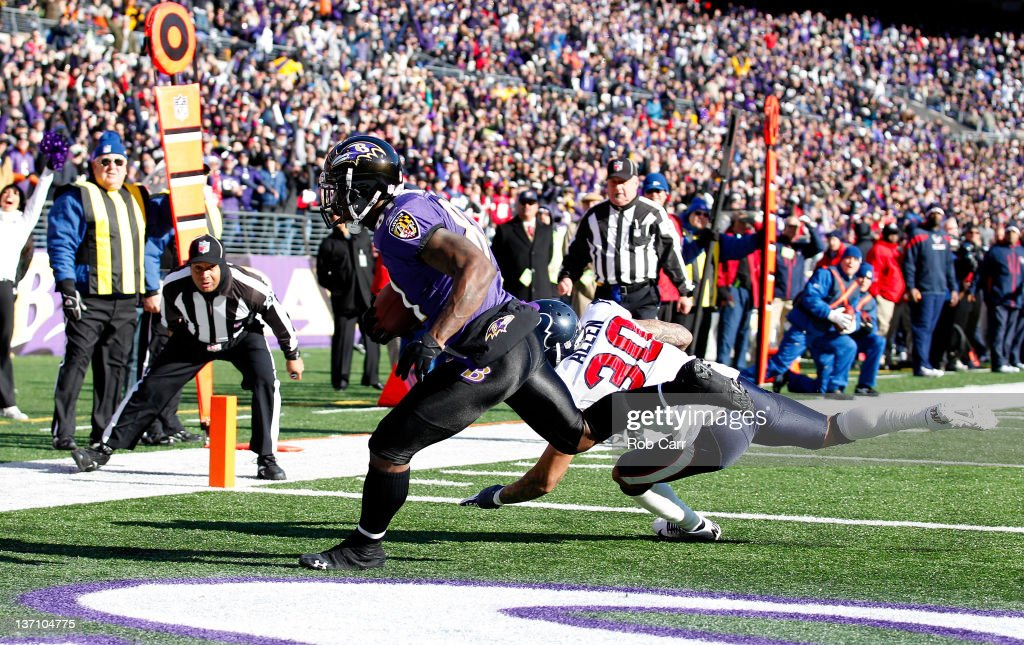 Anquan Boldin #81 of the Baltimore Ravens catches a pass against Jason Allen #30 of the Houston Texans to score a touchdown during the first quarter of the AFC Divisional playoff game at M&T Bank Stadium on January 15, 2012 in Baltimore, Maryland.
