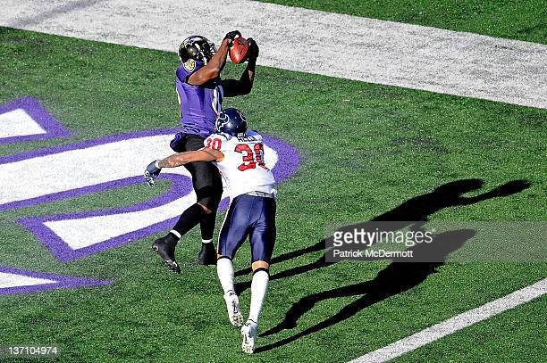 Anquan Boldin of the Baltimore Ravens catches a pass against Jason Allen of the Houston Texans to score a touchdown during the first quarter of the...