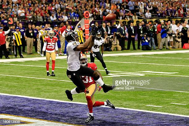 Anquan Boldin of the Baltimore Ravens catches a touchdown pass in the first quarter over Donte Whitner of the San Francisco 49ers during Super Bowl...