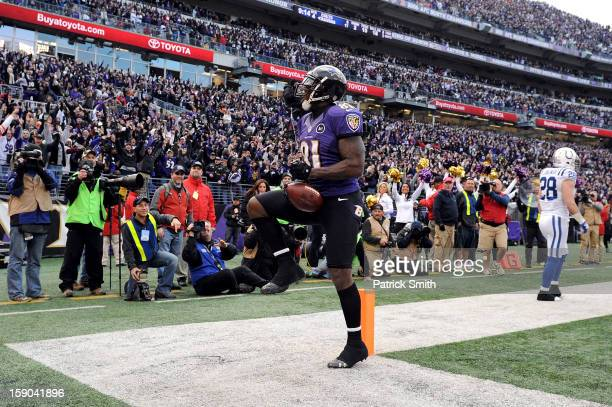 Anquan Boldin of the Baltimore Ravens celebrates after he scored an 18-yard touchdown reception in the fourth quarter against the Indianapolis Colts...