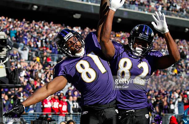 Anquan Boldin of the Baltimore Ravens celebrates scoring a touchdown with teammate Torrey Smith against the Houston Texans during the first quarter...