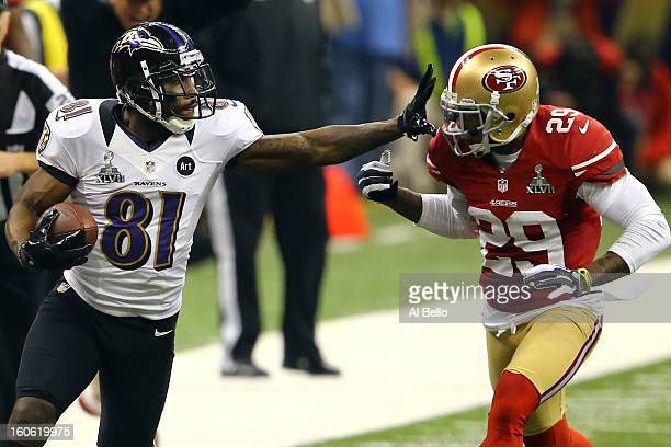 Anquan Boldin of the Baltimore Ravens runs with the ball past Chris Culliver of the San Francisco 49ers after catching a pass in the second half...