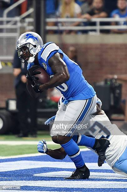 Anquan Boldin of the Detroit Lions catches a touchdown in front of Brice McCain of the Tennessee Titans during the first half of a game at Ford Field...