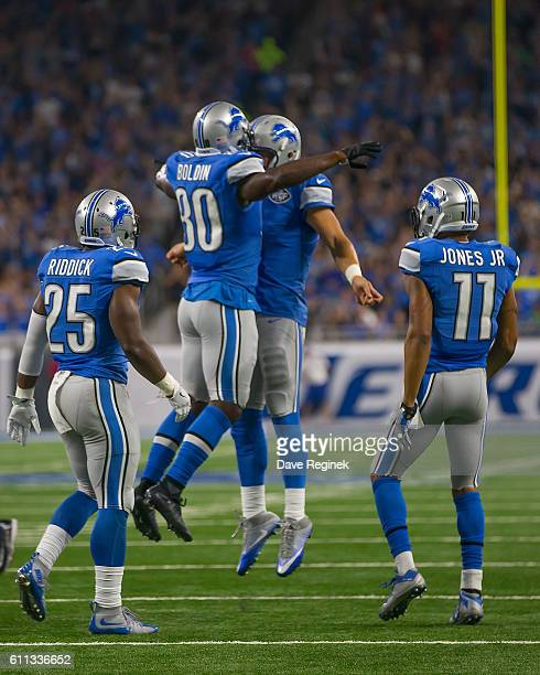 Anquan Boldin of the Detroit Lions celebrates with teammate Matthew Stafford after scoring a touch down in the first quarter against the Tennessee...