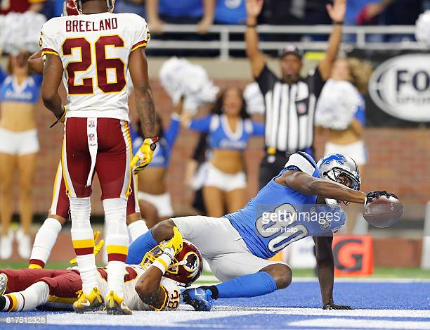 Anquan Boldin of the Detroit Lions makes a later fourth quarter touchdown as Kendall Fuller of the Washington Redskins attempts to make the stop...