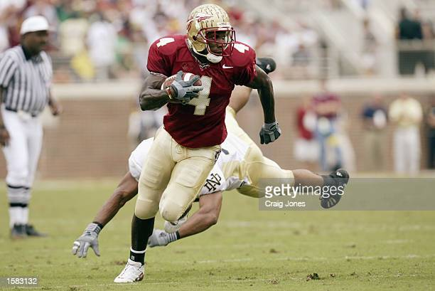 Anquan Boldin of the Florida State Seminoles is chased by Courtney Watson of the Notre Dame Fighting Irish at Doak Campbell Stadium on October 26...