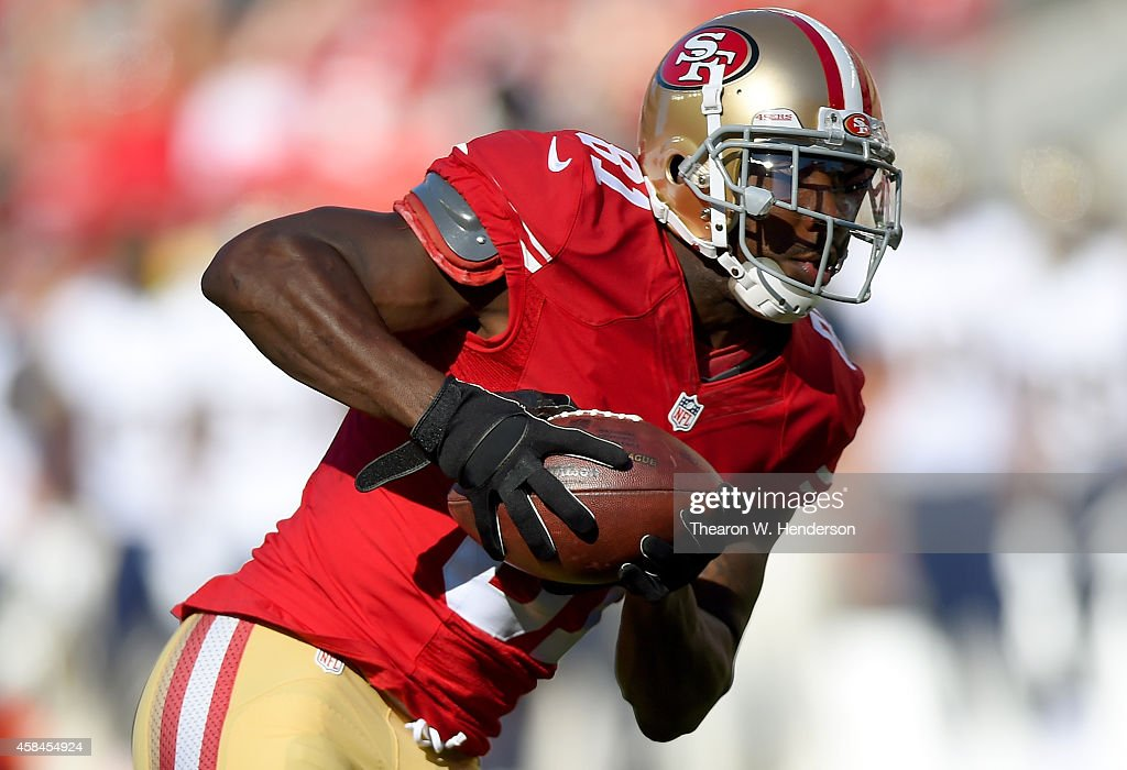 Anquan Boldin #81 of the San Francisco 49ers catches a pass and rushes up field for a touchdown against the St. Louis Rams during the second quarter at Levi's Stadium on November 2, 2014 in Santa Clara, California.