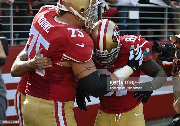 Anquan Boldin of the San Francisco 49ers celebrates with Alex Boone of the San Francisco 49ers after scoring the first touchdown against the...