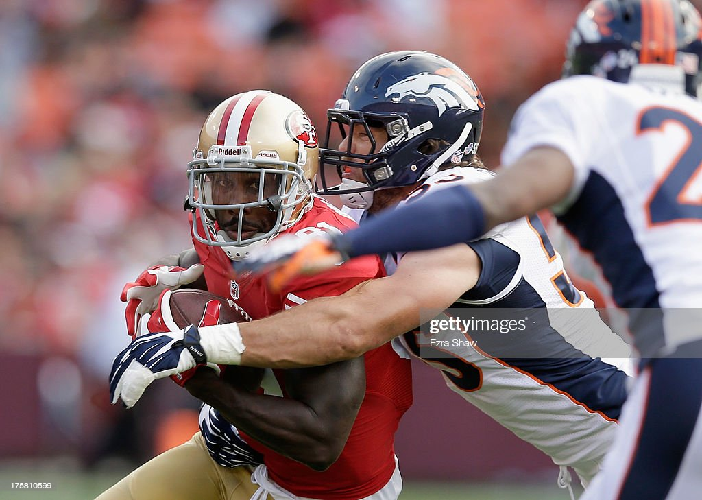 Anquan Boldin #81 of the San Francisco 49ers is tackled by Stewart Bradley #55 of the Denver Broncos during their preseason NFL game at Candlestick Park on August 8, 2013 in San Francisco, California.