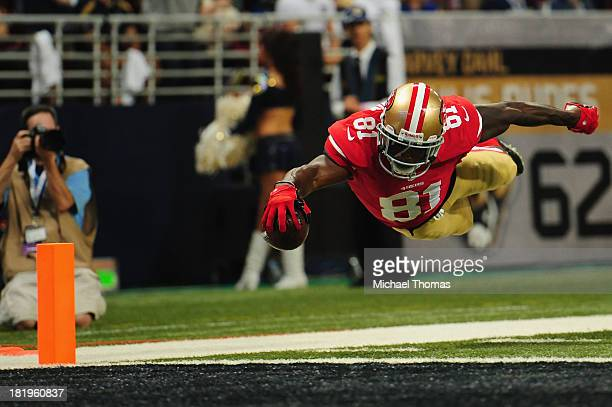Anquan Boldin of the San Francisco 49ers scores a touchdown against the St. Louis Rams at the Edward Jones Dome on September 26, 2013 in St. Louis,...