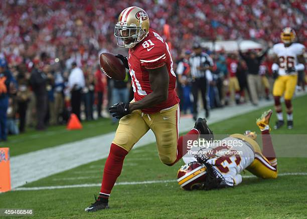 Anquan Boldin of the San Francisco 49ers scores the first touchdown as Brandon Meriweather of the Washington Redskins tries to make the tackle at...