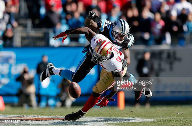 Anquan Boldin of the San Francisco 49ers tries to make a catch against Quintin Mikell of the Carolina Panthers in the second quarter during the NFC...