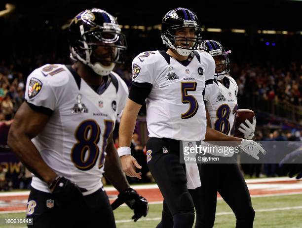 Anquan Boldin, Torrey Smith and Joe Flacco of the Baltimore Ravens celebrate after a touchdown in the second quarter against the San Francisco 49ers...