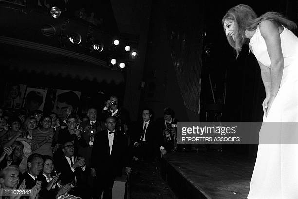 anquetil In The First Time Of Dalida At Olympia In Paris France On October 07 1967 Jeanine Jacques Anquetil and Annie and Dalida on stage