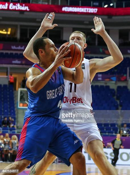 Anrew Lawrence of Great Britain vies with Rolands Smits of Latvia during the FIBA Eurobasket 2017 Group D Men's basketball match between Latvia and...