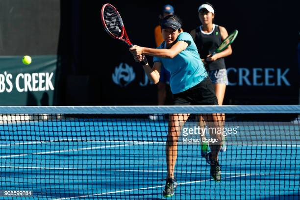 Anri Nagata of Japan and Moyuka Uchijima of Japan compete in their girl's doubles match against Elisabetta Cocciaretto of Italy and Sada Nahimana of...