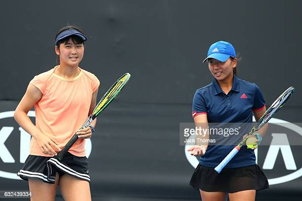 Anri Nagata of Japan and Thasaporn Naklo of Thailand compete in their first round match against Yi Tsen Cho and Joanna Garland of Taipei during the...