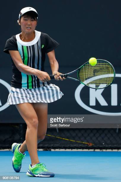 Anri Nagata of Japan plays a backhand against Diane Parry of France during the Australian Open 2018 Junior Championships at Melbourne Park on January...