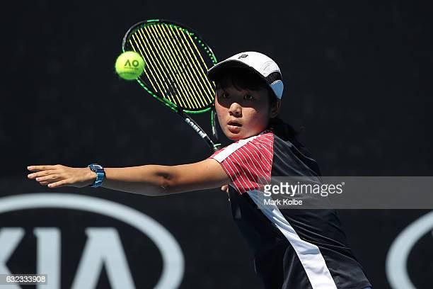 Anri Nagata of Japan plays a shot against Alexandra Bozovic of Australia during the Australian Open 2017 Junior Championships at Melbourne Park on...