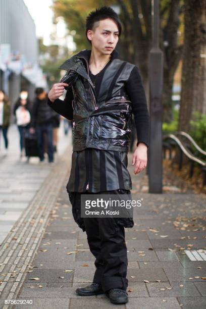 Anri wearing a Sexprime black jacket Julius cargo black pants leather black shoes and a zipped tunic leather and black shirt stops for a fashion snap...