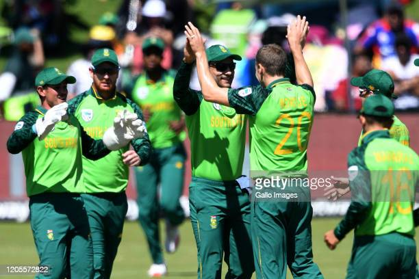 Anrich Nortje of the Proteas celebrates the wicket of David Warner of Australia with his team mates during the 3rd ODI match between South Africa and...