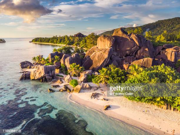 anse source d'argent taken at sunset from a drone - la digue island stock pictures, royalty-free photos & images
